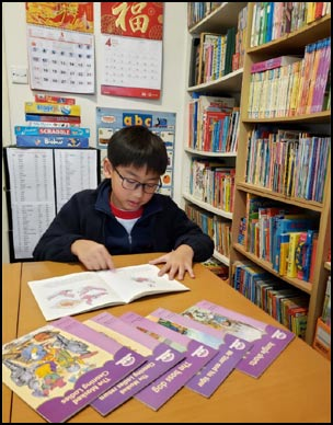 A primary student enjoys reading from the Oxford Reading Tree series